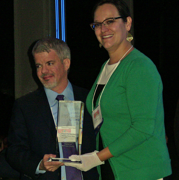 Chris Hartye (City of Hillsboro Oregon) receives the award for Organization of the Year from Leah